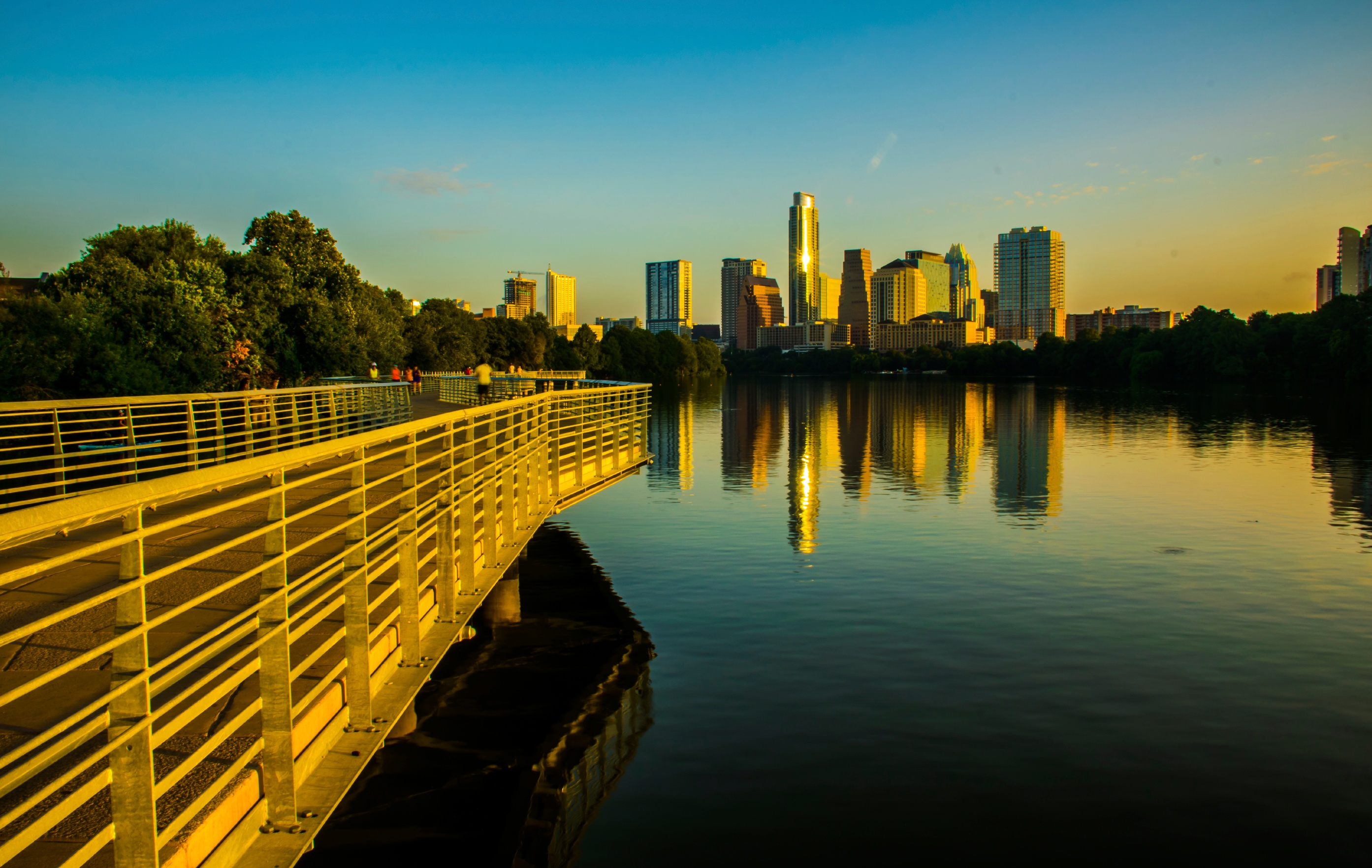 A view from the Lady Bird Lake of high rises in downtown Austin offering replacement property options for 1031 exchange investors.