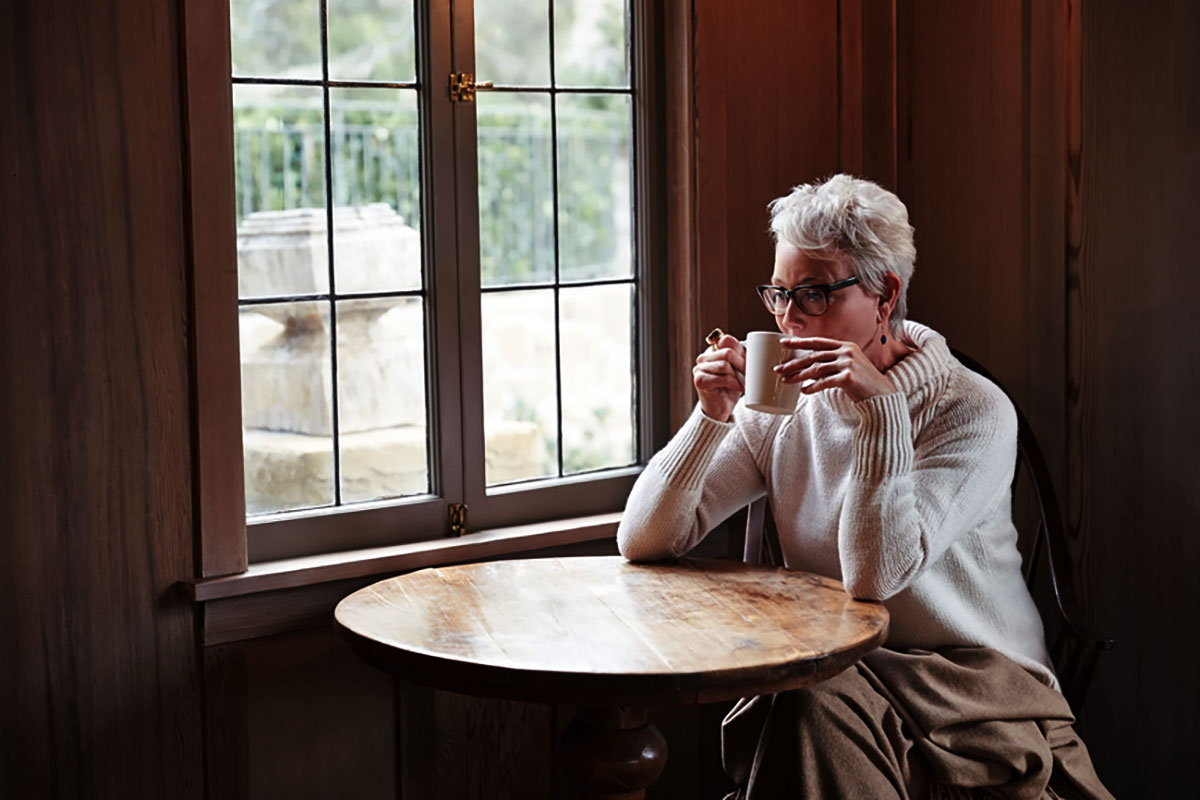 A woman drinking coffee trying to figure out if she qualifies for a 1031 exchange.