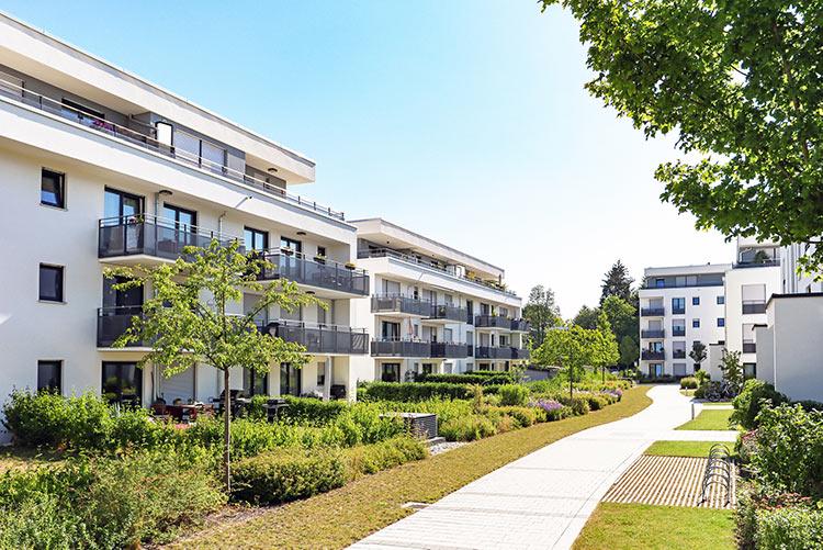 apartment-trees-sidewalk-IS-1161036960