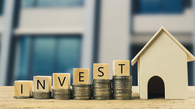 coins-stacking-to-house-invest-in-real-estate-AS-265319498