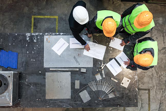 construction-workers-hard-hats-paper-IS-1139489459