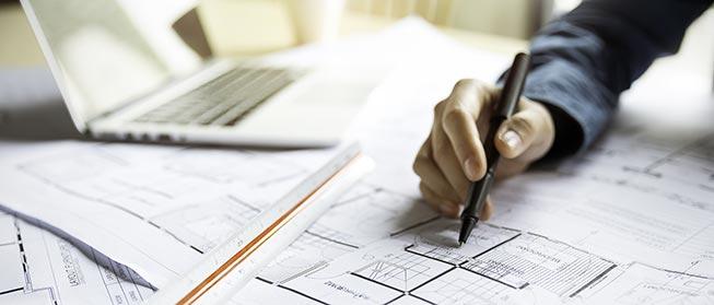 hand-pen-plans-laptop-AS-298394475