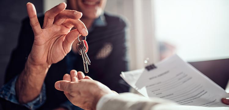 handing-keys-paper-IS-1132329631