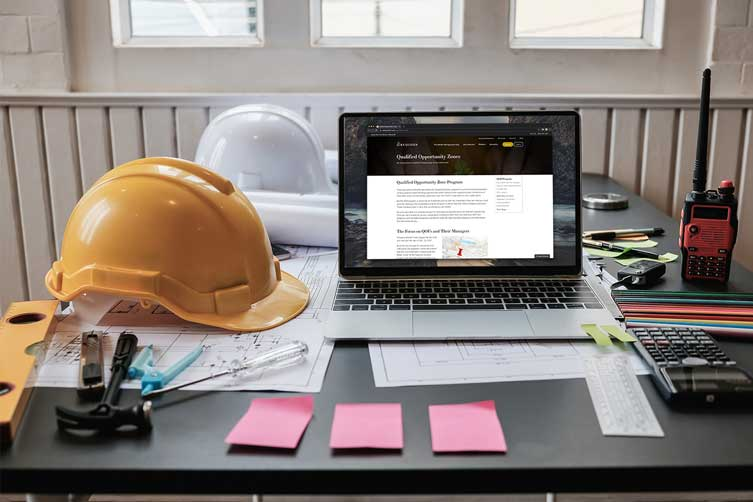 hard-hats-laptop-sticky-notes-IS-1174841527