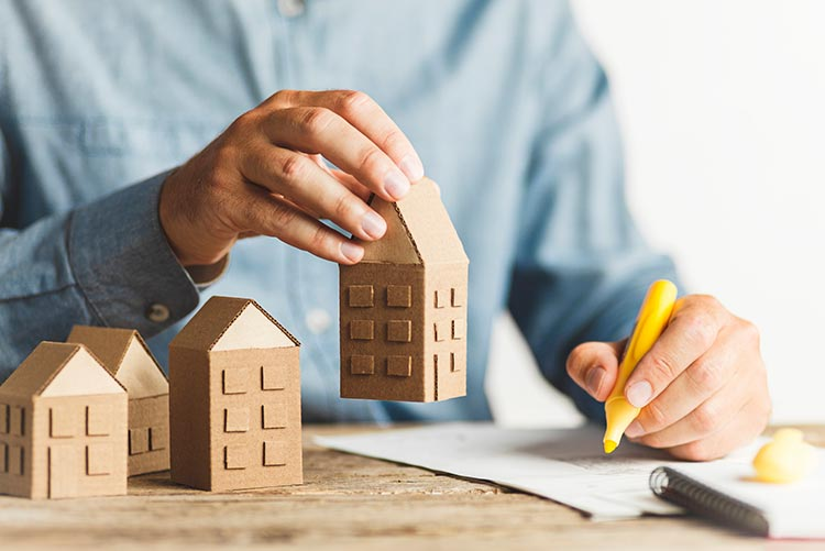 holding-wooden-houses-IS-1266750157