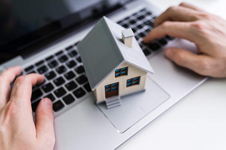 house-on-laptop-IS-1213744787