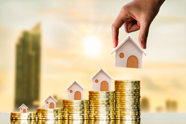 houses-stacking-on-coins-capital-gains-AS-269739065
