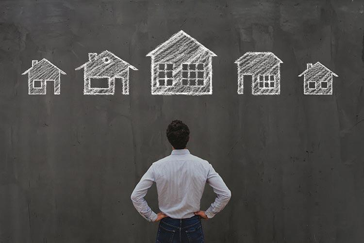 man-blackboard-houses-IS-1212135578
