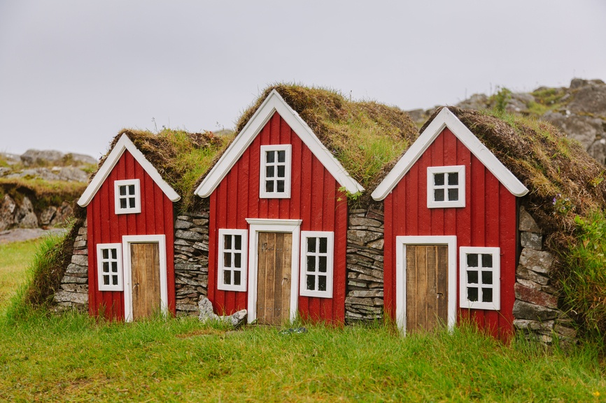 An image of three old-fashioned houses, that represent the long history of 1031 exchanges.
