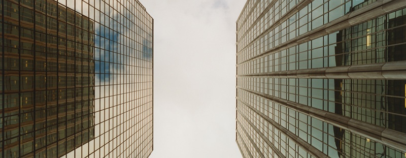 Image of two corporate high rises, whose value can be estimated using cash on cash.