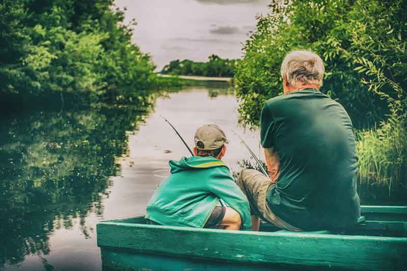 Grandparent fishing with grandson
